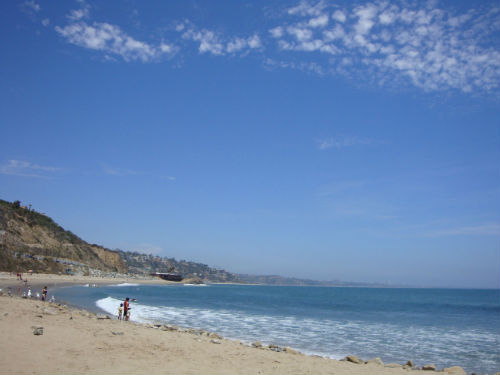 sunny puffy cloud beach